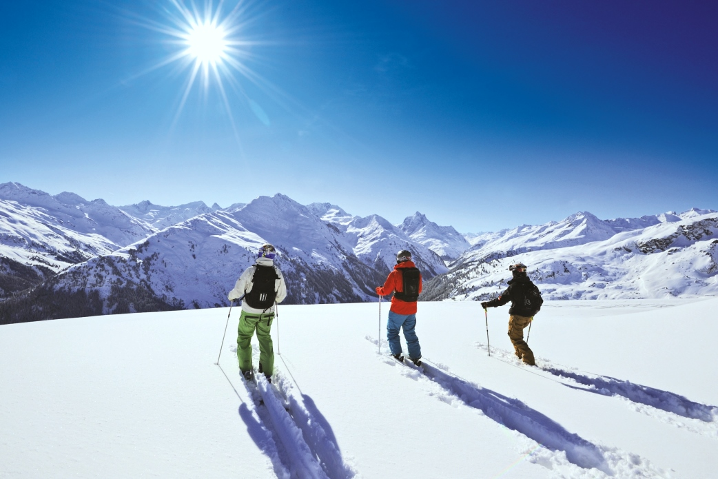 Ski Total | Skiers off piste looking at the view