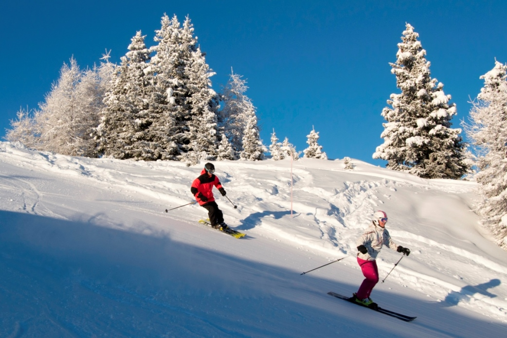 Ski Total | skiers enjoy the empty slopes in Verbier