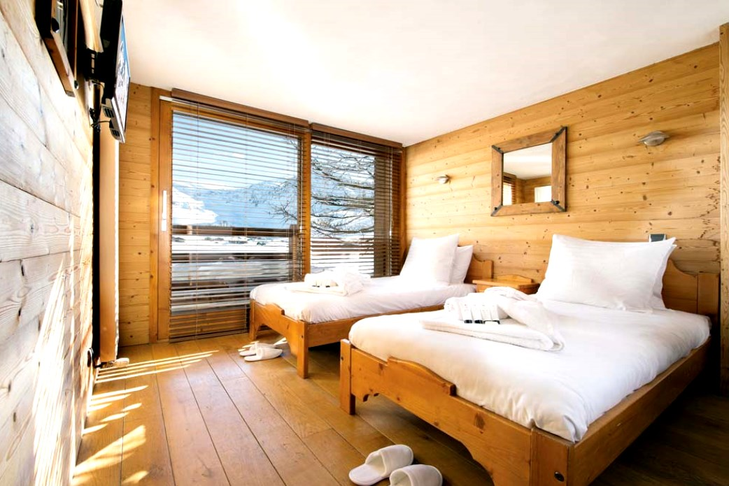 Ski Total | A typical bedroom in the chalet Cairn