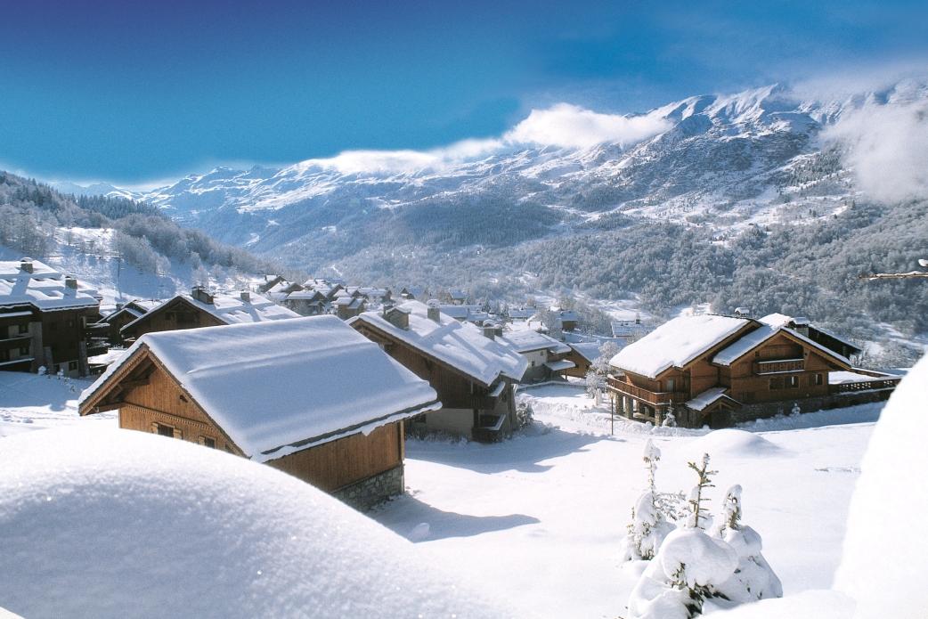 Ski Total   Snow topped chalets in Meribel
