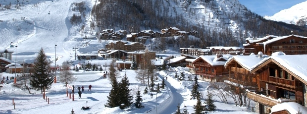 Ski Total | Val d'Isere centre with the slopes with the background