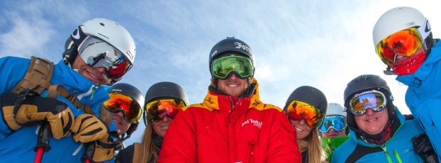 Ski Total | Ski Total Representative and a group of guests smiling for the camera