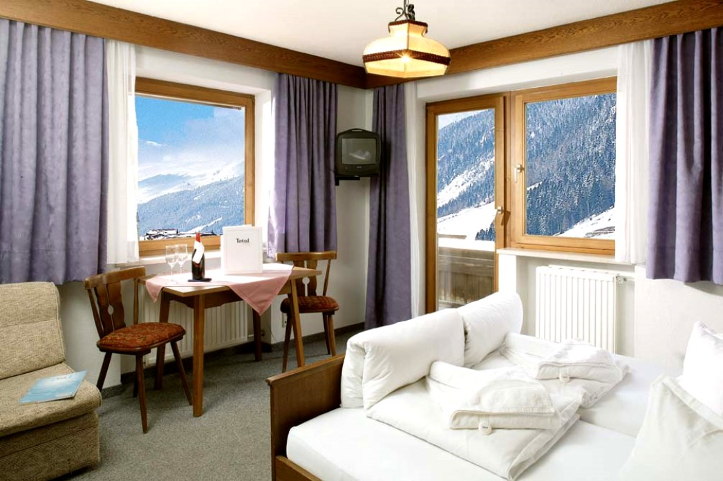 Ski Total | A typical bedroom in the chalet Zita