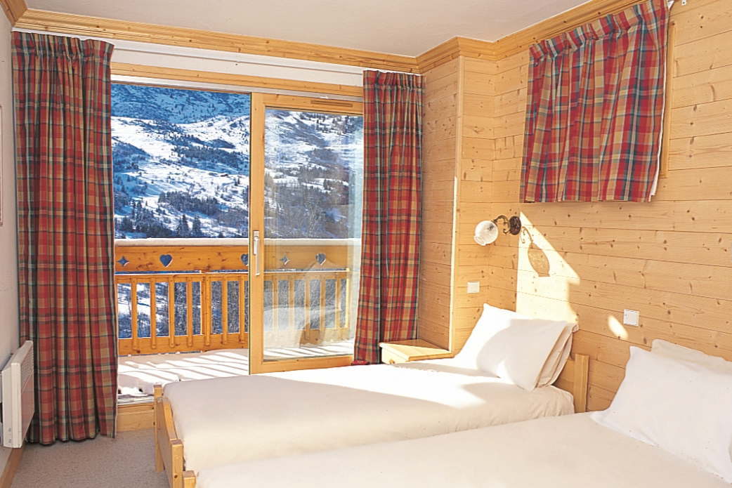Ski Total   A typical bedroom in the chalet Mélèze Doré