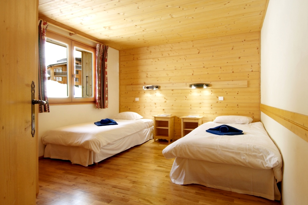 Ski Total | Typical bedroom style in the chalet Perce Neige