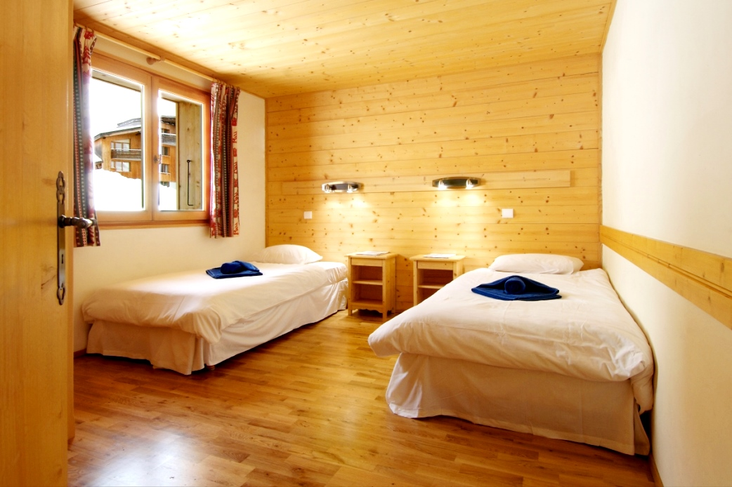 Ski Total | A typical bedroom in the chalet Violetta