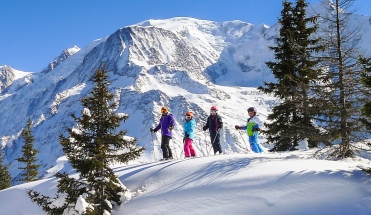 Ski Total | A Family stopping to take in the mountain view