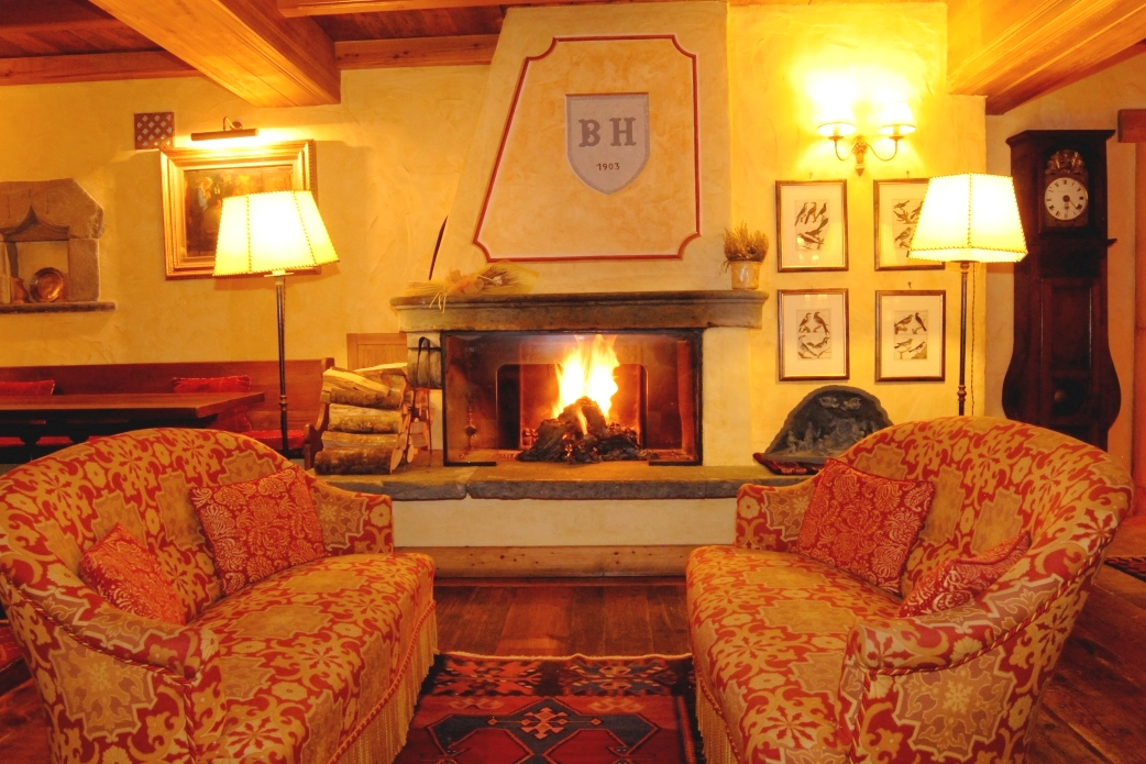 Ski Total | A comfy sitting area in front of a roaring fire