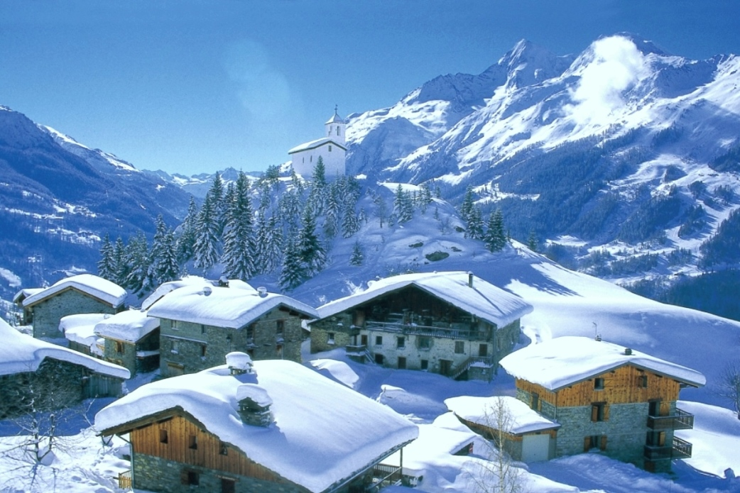 Ski Total | La Rosiere view with a snowy church