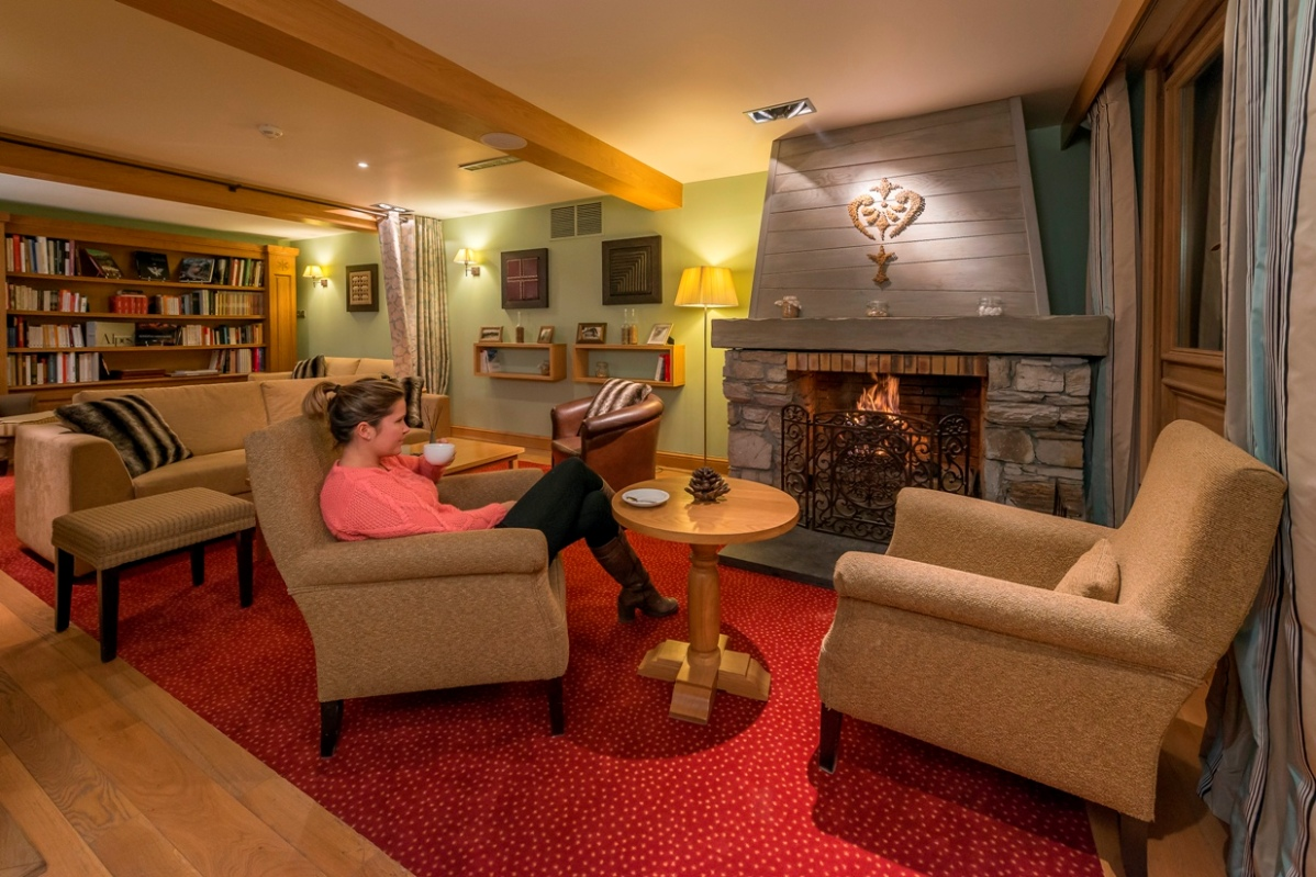 Ski Total | Chalet Hotel Le Savoie Lounge with Open Fire