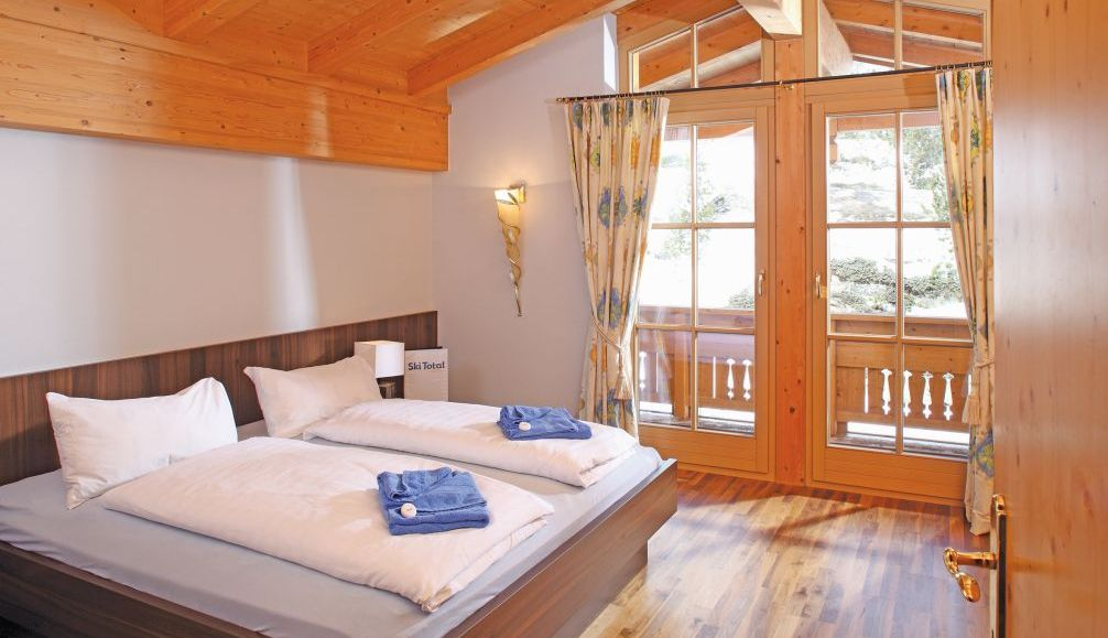 Ski Total | A typical bedroom in the chalet Angela