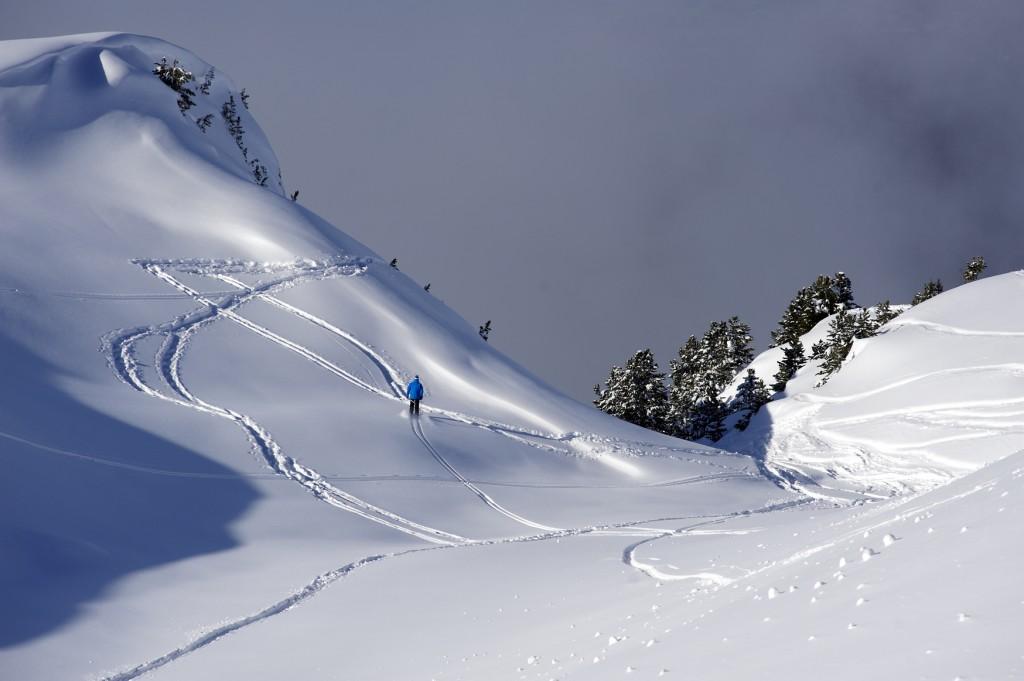 Courchevel skier making tracks on off piste