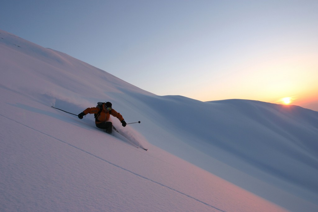 Skiing at sunset off piste