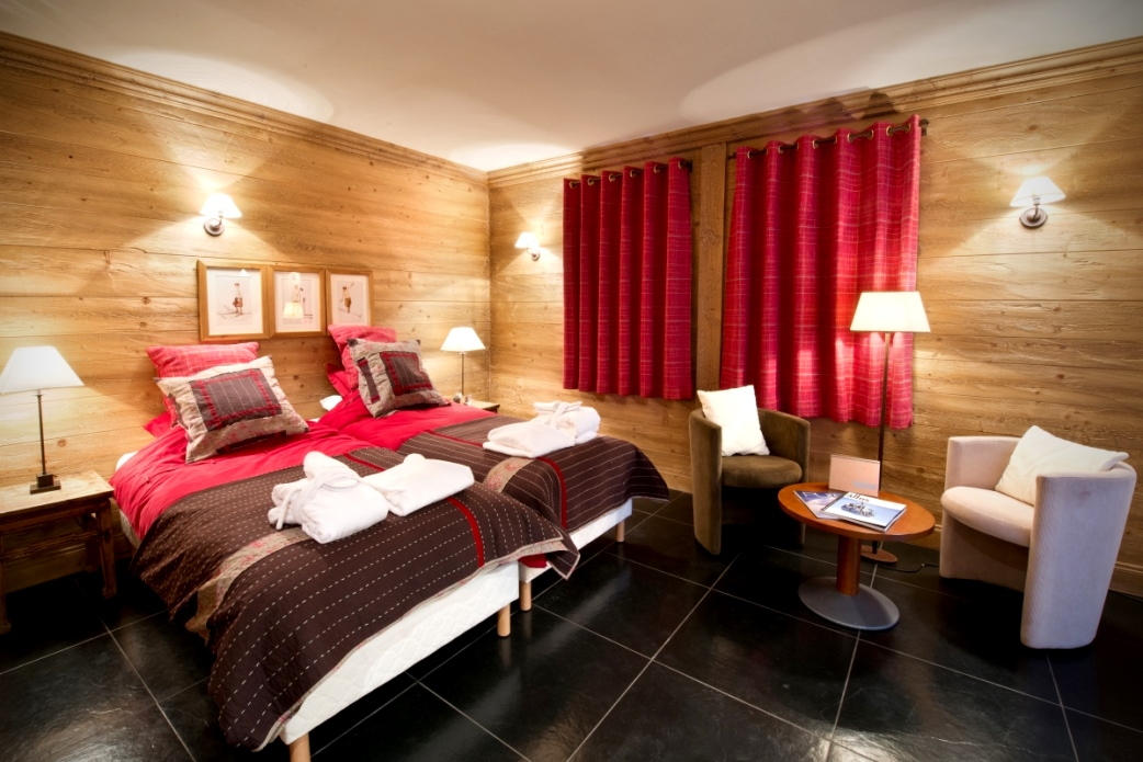 Ski Total | A typical bedroom in the chalet La Vieille Forge