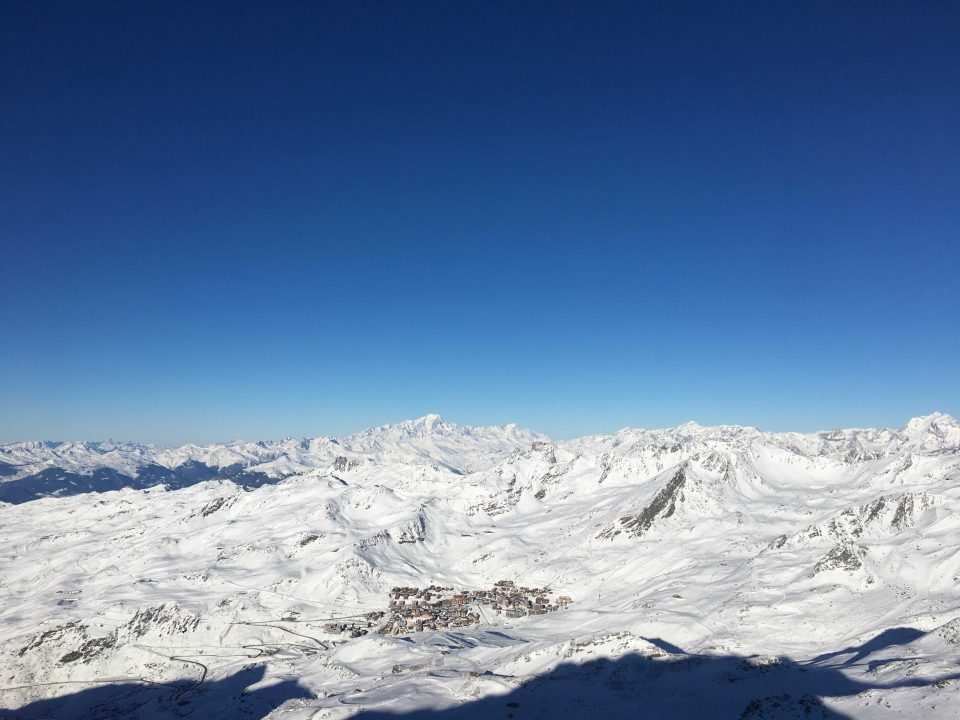 Ski Total | Val Thorens from afar on a clear, bluebird day