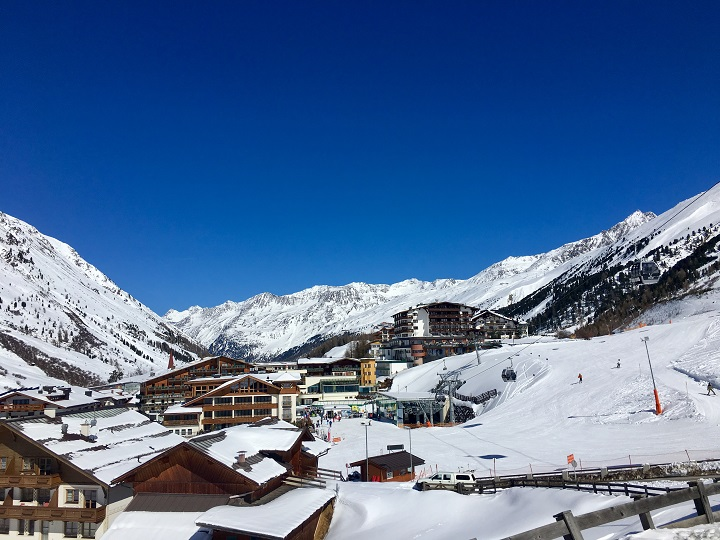 Ski Total | Obergurgl town built into the mountain with bluebird skies