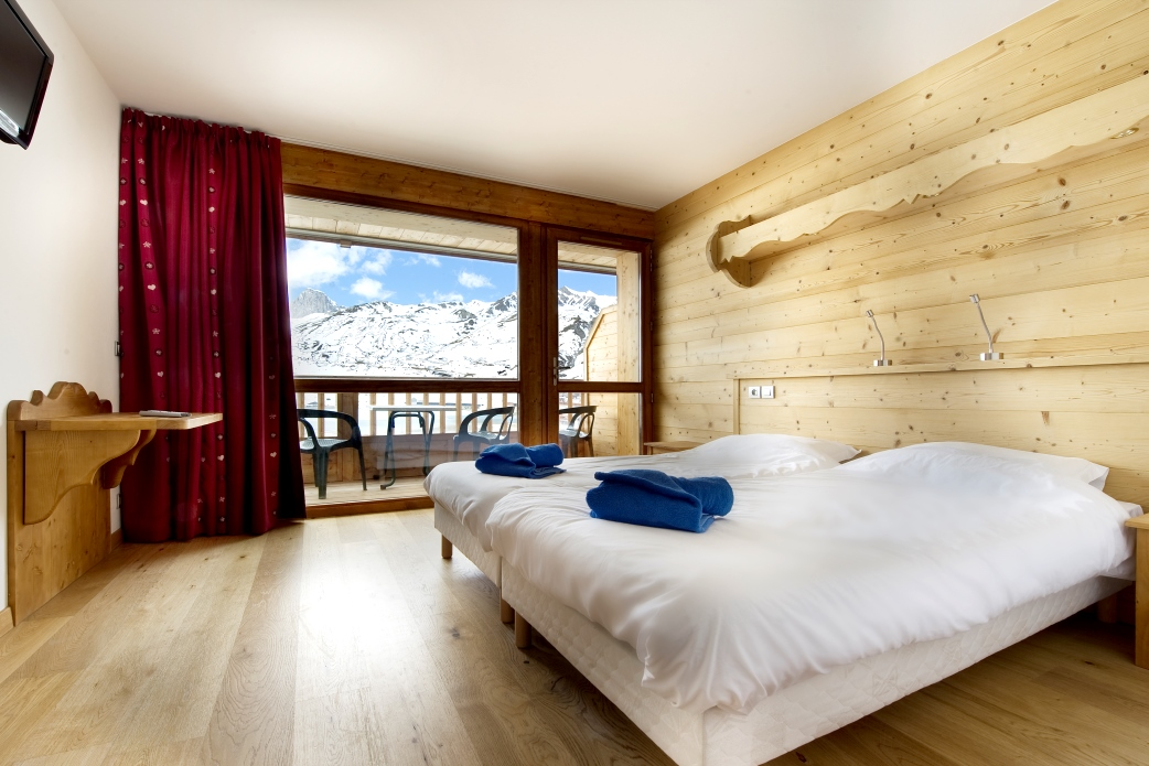 Ski Total | A typical bedroom in the chalet Corniche